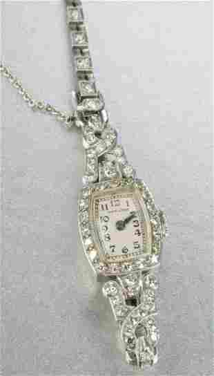 A LADIES PLATINUM AND DIAMOND WRISTWATCH.