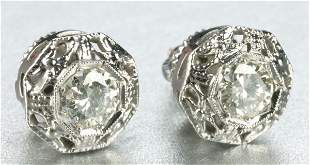 A PAIR OF WHITE GOLD AND DIAMOND EARRINGS.