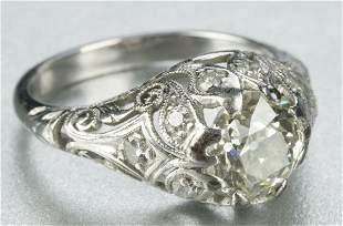 A PLATINUM AND DIAMOND RING.
