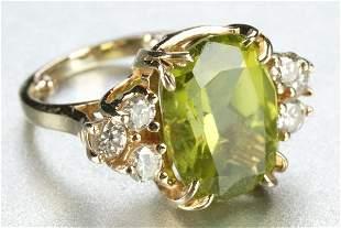 A 14K YELLOW GOLD, PERIDOT AND DIAMOND RING.