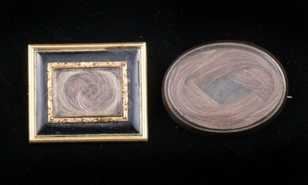 1187: TWO VICTORIAN WOVEN HAIR MOURNING BROOCHES. mid-1