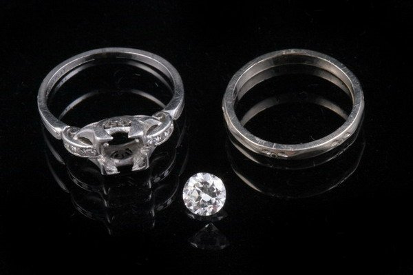 1202: LADY'S PLATINUM AND DIAMOND ENGAGEMENT TYPE RING.