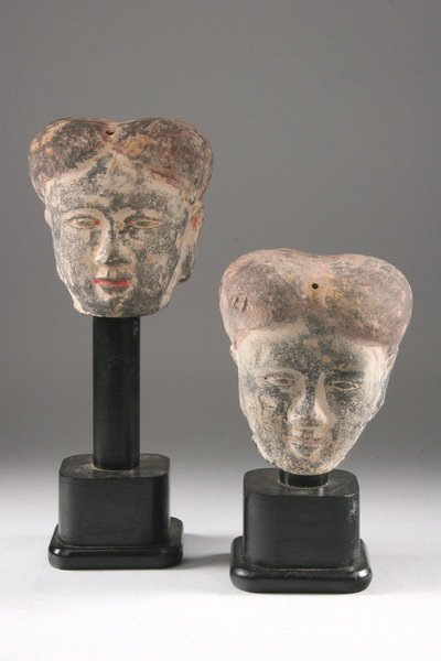 6: TWO CHINESE POLYCHROME GREY POTTERY HEADS, Han dynas