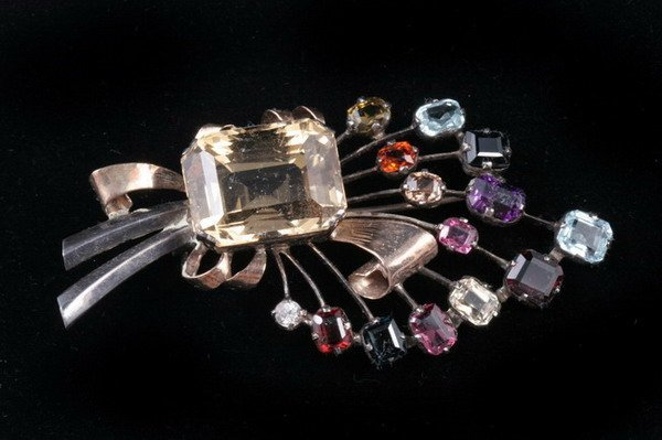 1068: YELLOW GOLD, SILVER AND COLORED GEMSTONE FLORAL S