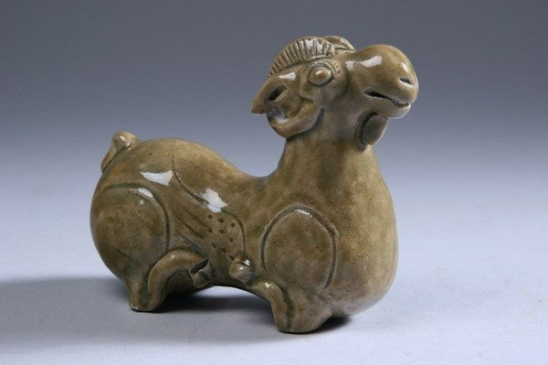 13: CHINESE CELADON PORCELAIN FIGURE OF A RAM. - 3 3/4