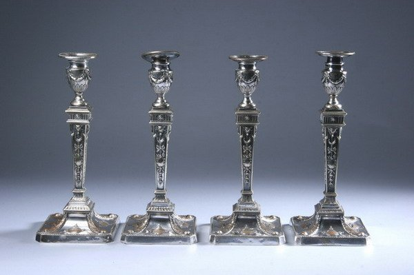 609: FOUR SILVER PLATED ADAM-STYLE CANDLESTICKS. 19th c