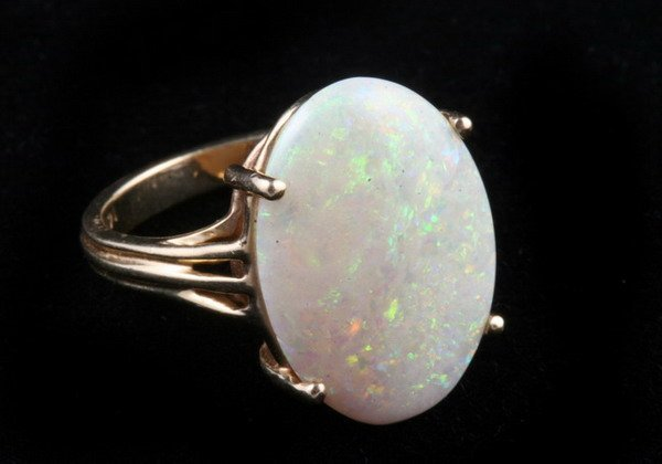 1137: 14K YELLOW GOLD AND PRECIOUS WHITE OPAL RING,