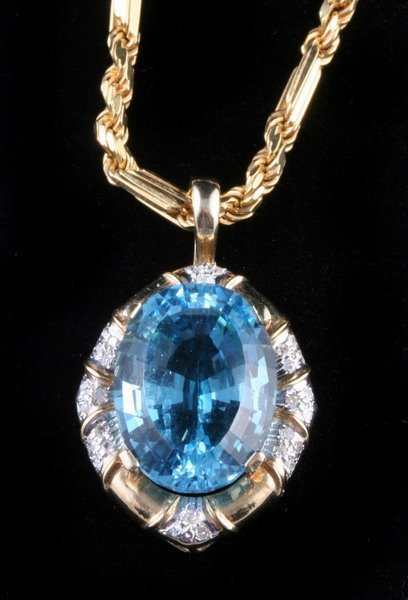 1155: 14K YELLOW GOLD, DIAMOND AND BLUE TOPAZ PENDANT O