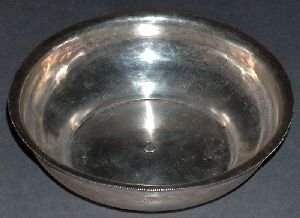 A MIDDLE EASTERN SILVER LOW BOWL. Flaring rim, stam