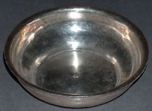 12: A MIDDLE EASTERN SILVER LOW BOWL. Flaring rim, stam