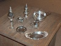 19: A GROUP OF AMERICAN SILVER HOLLOWWARE, 20th century