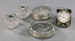 AN AMERICAN SILVER EIGHT-DAY TRAVEL CLOCK AND FOUR