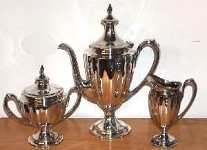 A THREE-PIECE AMERICAN SILVER COFFEE SERVICE, By In