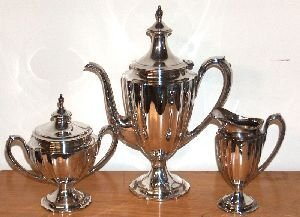 26: A THREE-PIECE AMERICAN SILVER COFFEE SERVICE, By In