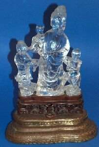 497: A CHINESE ROCK CRYSTAL FIGURAL GROUP. Carved to de