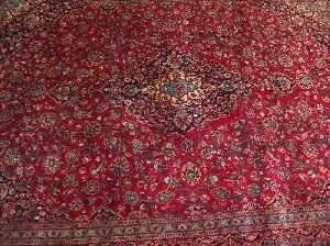 646: AN IRANIAN KASHAN RUG, With a small blue center me
