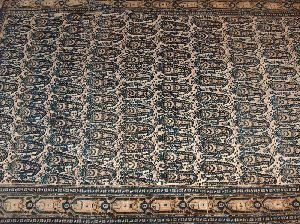 691: AN ANTIQUE SENNEH RUG, With allover drawing of elo