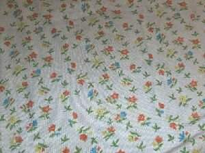 A PORTUGUESE NEEDLEPOINT RUG, All over floral draw