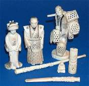 764: THREE JAPANESE IVORY OKIMONO. Carved to depict an