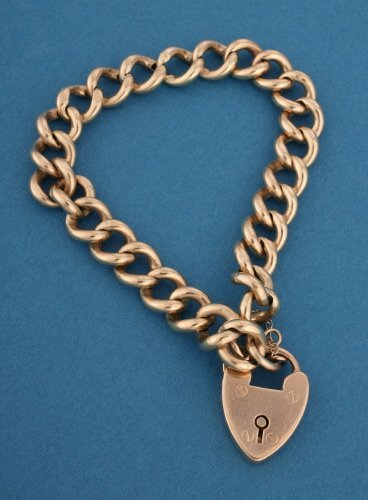 808: A VICTORIAN YELLOW GOLD BRACELET AND LOC