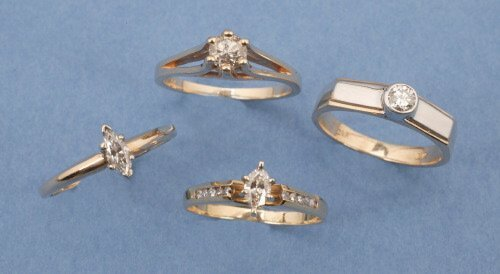 820: A GROUP OF 14K YELLOW GOLD AND DIAMOND R
