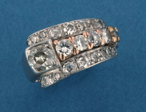 823: A PLATINUM, PINK GOLD AND DIAMOND RING.