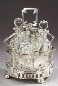 1: AN ENGLISH SILVER PLATED CRUET SET.  The silver plat