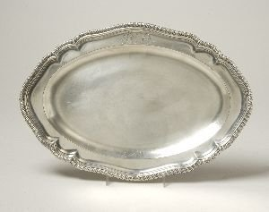 5: A GEORGE III SILVER SHAPED OVAL MEAT PLATTER. George