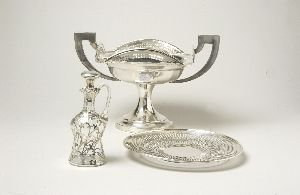 14: A COLLECTION OF SILVER PLATE.  Including a water pi