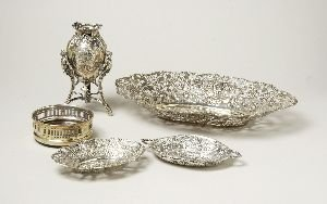 17: A COLLECTION OF SILVER AND SILVER PLATE .  Includin