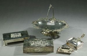 18: FIVE PIECES OF SILVER PLATE.  Comprising: a wood li