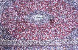 843: AN IRANIAN KASHAN RUG, With a center medallion on