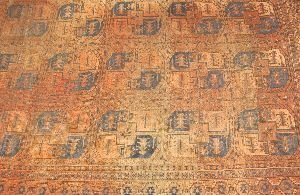 922: AN ANTIQUE AFGHAN RUG,  11ft. 2in. x 8ft. 7in.