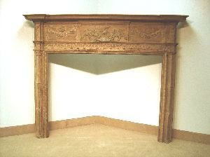 1091: A GEORGE III STYLE CARVED PINE AND GESSO MANTEL.