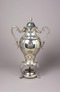 A SILVER PLATED COFFEE URN. Of bulbous shape with s