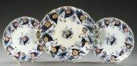 NINE ENGLISH IRONSTONE DINNER PLATES AND A CHARGER,