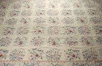 A FLORAL NEEDLEPOINT RUG, 20th century. Approx. 9