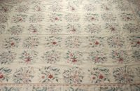 700: A FLORAL NEEDLEPOINT RUG, 20th century.  Approx. 9
