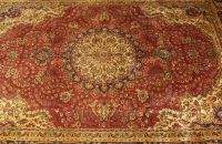 A PERSIAN TABRIZ RUG, 6ft. 9in. x 9ft. 7in.