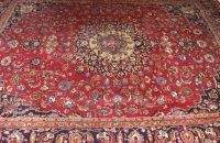 A PERSIAN MASHAD RUG, 9ft. 9in. x 13ft. 11in.
