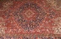 A PERSIAN SEMI ANTIQUE HERIZ RUG, 7ft. 9in. x 10f
