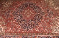 718: A PERSIAN SEMI ANTIQUE HERIZ RUG,  7ft. 9in. x 10f