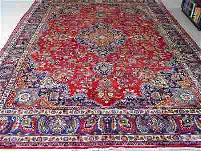 221: A Mashad Rug, Approx. 12 ft. 10 in. x 9