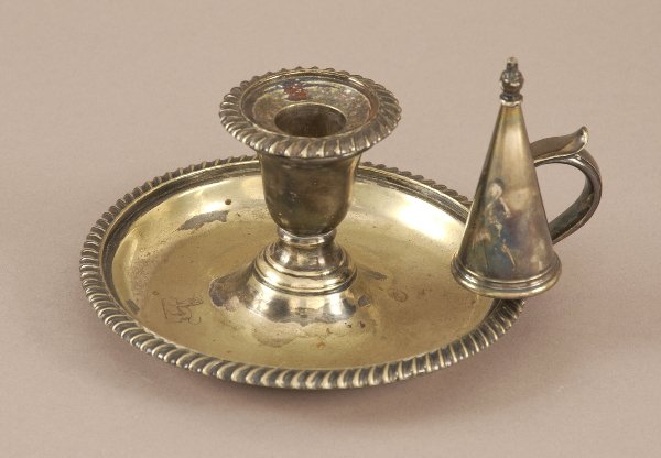 5: A SILVER PLATED CHAMBERSTICK. With conical extinguis
