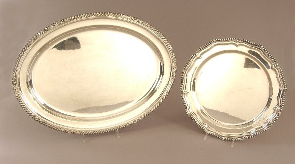 6: TWO ENGLISH SILVER PLATED SERVING PLATTERS. The firs