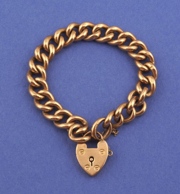 649: A VICTORIAN 9 KARAT GOLD BRACELET WITH HEART PADLO