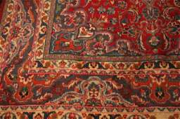 705: A SEMI-ANTIQUE PERSIAN MASHAD RUG, Includes red fi