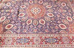 718: A PERSIAN MASHAD RUG, Approx. 9 ft. 10 in x 13 ft