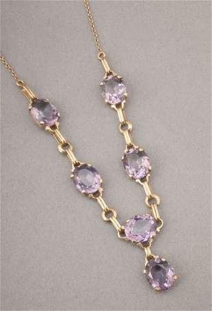 A 14K YELLOW GOLD AND AMETHYST NECKLACE.
