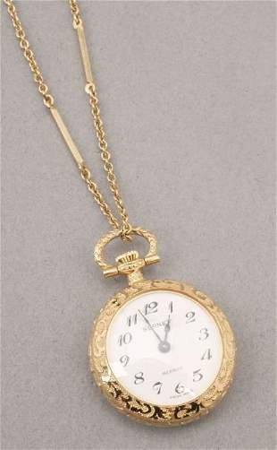 A LADY'S 14K YELLOW GOLD OPEN-FACED POCK